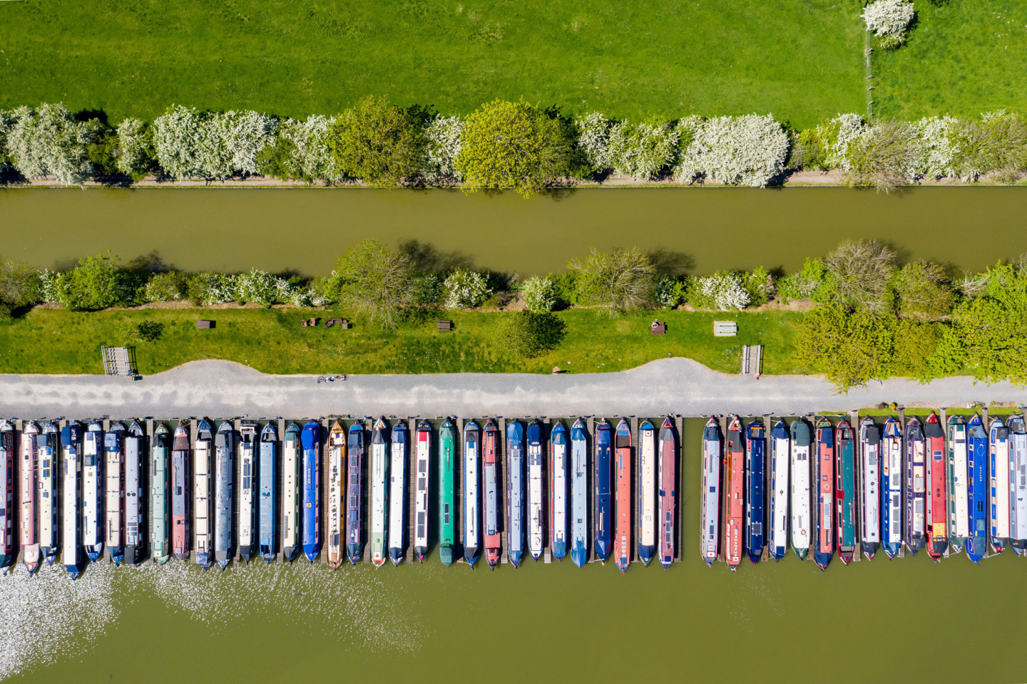 Canal boats lining the Grand Union Canal at Crick, Northamptonshire. They can only be used for essential travel. © Geoff Robinson
