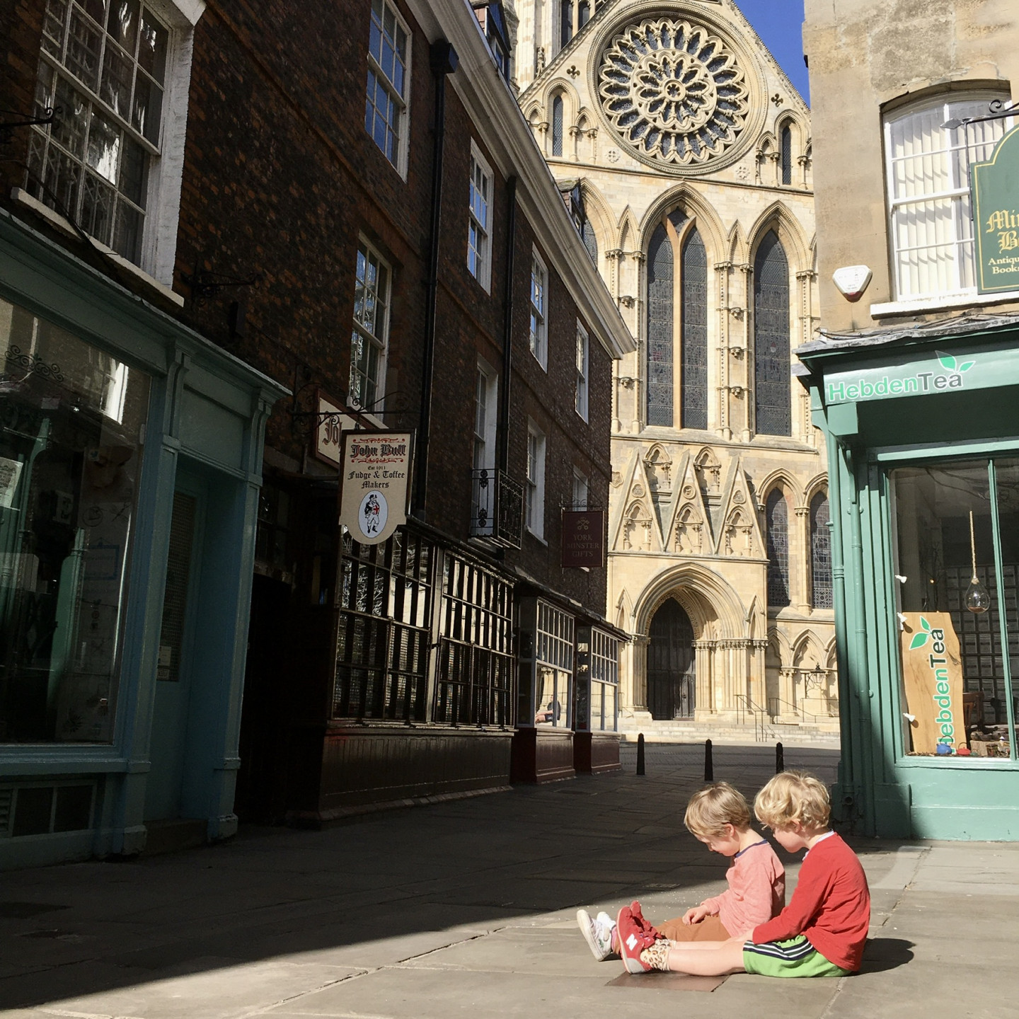 This photo was taken on Tuesday 7th April. I was trying to get a snap of the Minster peeping through and suddenly my sons ran in and sat like this. I thought it was a lovely moment of quiet friendship in the deserted streets of York.  © Laura Bird