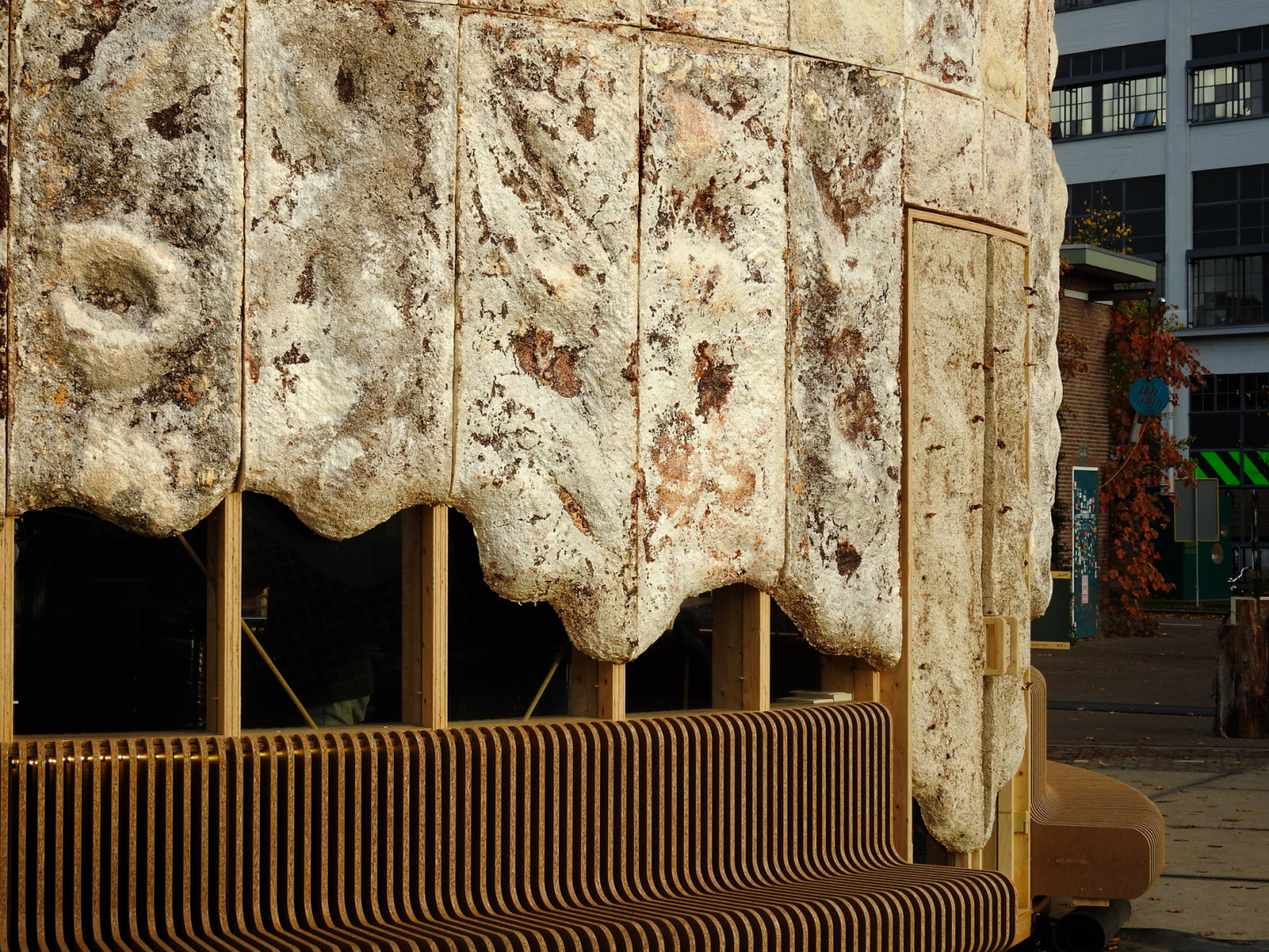 Facade of The Growing Pavilion is covered with mycelium panels designed by Krown.bio. The benches are made of rice straw ECO-Boards by Fiction Factory © Photos Eric Meander